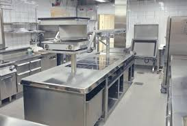 commercial kitchen with rectangle stainless steel kitchen island