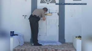 halloween city santa clarita deputy shows kindness to saugus widow paints over graffiti at her