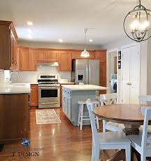 kitchen ideas for light wood cabinets should i paint my oak cabinets or keep them stained
