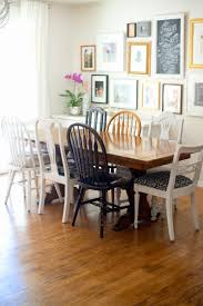 domestic fashionista dining room decor and refinished hardwood floors when we originally got our new hand me down table i thought i wanted to paint all the chairs white but now the mismatched chairs are growing on me again