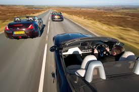 nissan 370z vs evo x nissan 370z roadster v audi tt s roadster v bmw z4 35i evo