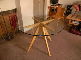 dining round dining table wood base and glass on top surface