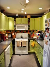 green and yellow kitchen ideas with marble and pendant light