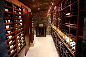 Under Cabinet Track Lighting Wine Storage Room Design Wine Cellar Traditional With Stone Wall