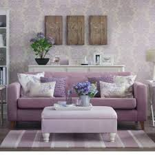 feminine living room with purple damask wallpaper and purple sofa