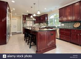 modern kitchen with cherry wood cabinets kitchen in luxury home with cherry wood cabinetry stock