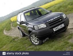 light blue land rover 2002 land rover freelander mark 1 off road in the countryside