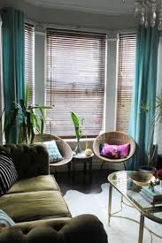 cute living room decoration using turquoise triple window curtain