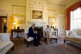 file secretary kerry sits with british prime minister may in the