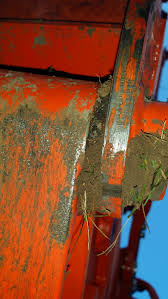 backhoe kubota delivery dirt jammed into lower boom pin and frame