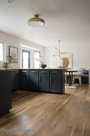 kitchen reveal with dark cabinets and open shelving shiplap wood