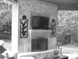 paint brick fireplace to look like stone painting concrete patio