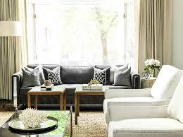 dark gray coffee table dark gray sofa with black trellis pillows transitional living room