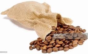 small burlap bags a small burlap bag with coffee beans spilling out stock photo