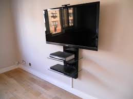 interior wall mounted flat screen tv with black wooden floating