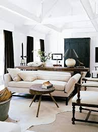 Cowhide Rug In Living Room 5 Brilliant Ways To Style Cowhide Rugs Thou Swell