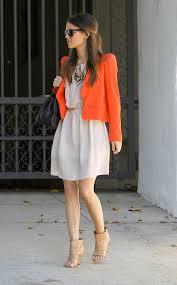 rachel bilson white dress gold statement necklace orange jacket