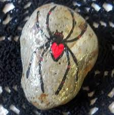 a cute little garden spider painted in acrylics on a rock great