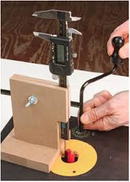 how to use a router table how to use your dial caliper to set exact router bit height on your