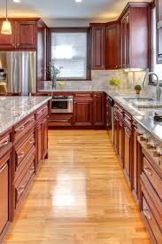 white kitchen cabinets black tile floor cabinets with white granite countertops countertopsnews