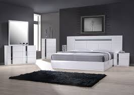 white gloss bedroom set with simple slender lines and modern bed