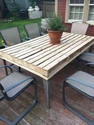 reclaimed wood outdoor table wood outdoor dining table exotic wood round outdoor dining table by