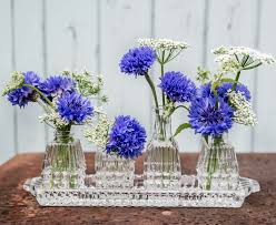 wedding flowers birmingham june blue cornflowers in a vintage pressed glass cruet set by