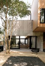 the 270 sq m of the house are three distinct elements a concrete
