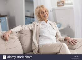 elegant mature woman elegant mature woman posing on couch stock photo royalty free image