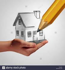dream home concept as a hand holding a drawing of a family house
