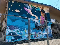 los angeles mural mile a pacoima arts revolution writing is suenos painted on the side of pacoima charter elementary is themed after the elements of steam education co designed by levi ponce this mural was the