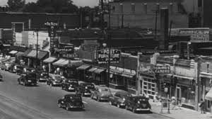usa 1940s small town street traffic and storefronts americana