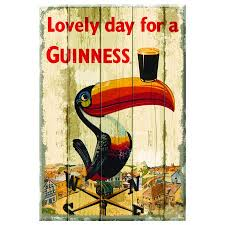 guinness wooden sign with toucan on weathervane design