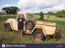 jeep pickup young teen standing beside old vintage willys jeep pickup truck