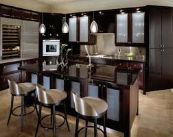 Functional Kitchen Cabinets by Dark Brown Leather Coated Chairs Orange Glass Pendant Lamp Black
