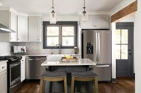 light gray cabinets with dark gray kitchen island transitional