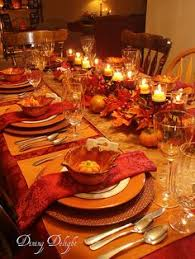 fall table decorations leaves and orange candles make for the intimate