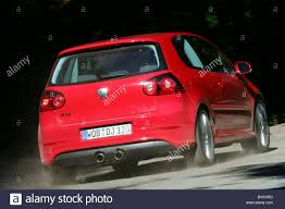 red volkswagen golf vw volkswagen golf r32 model year 2005 red driving diagonal