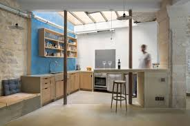 parisian kitchen design small budget renovation reveals a loft u0027s parisian charm