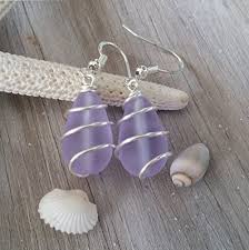 sterling silver earrings for sensitive ears handmade in hawaii wire wrapped purple sea glass earrings
