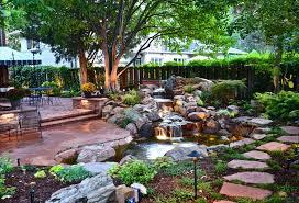 exterior design outdoor lighting with backyard waterfalls