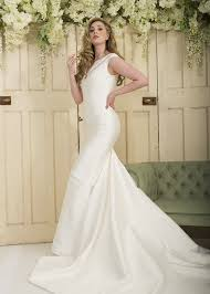 slim fit n flare wedding dress with cap sleeve and godet train