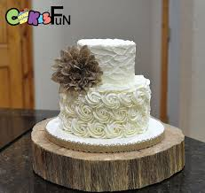 rustic buttercream wedding cake 2 tiers with burlap flower
