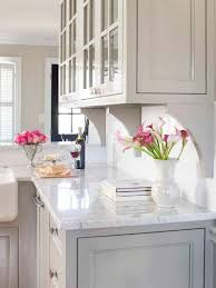 light gray kitchen cabinets with marble countertops neutral kitchen with marble countertop hgtv