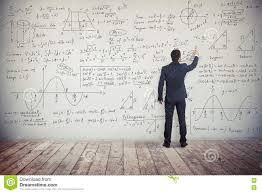man is writing solution of mathematical tasks on the wall stock