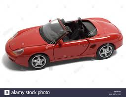 porsche model car red porsche boxster convertible toy car on white background stock