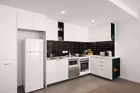 10 Beautiful Kitchens With Glass Cabinets Kitchen Wooden Kitchen Top 10 Kitchen Designs Cream Kitchen