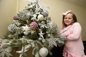 The Christmas Tree In The Bible - festive family so excited for christmas they have put their tree