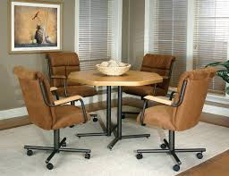 dining room chairs with rollers articles with supreme furniture dining set tag fascinating