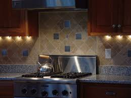 kitchen brown wooden kitchen cabinet with cream tiled back splash